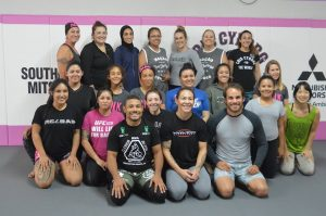 Former opponents inside the UFC cage unite for an event aimed at empowering women -